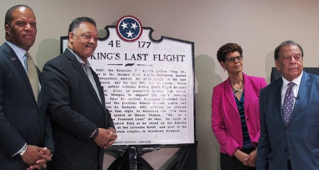 Jesse Jackson, second from left, and Andrew Young, second from right, pose for photos after the unveiling of a historical marker at Memphis International Airport commemorating final flight of slain civil rights leader Martin Luther King (AP Photo)