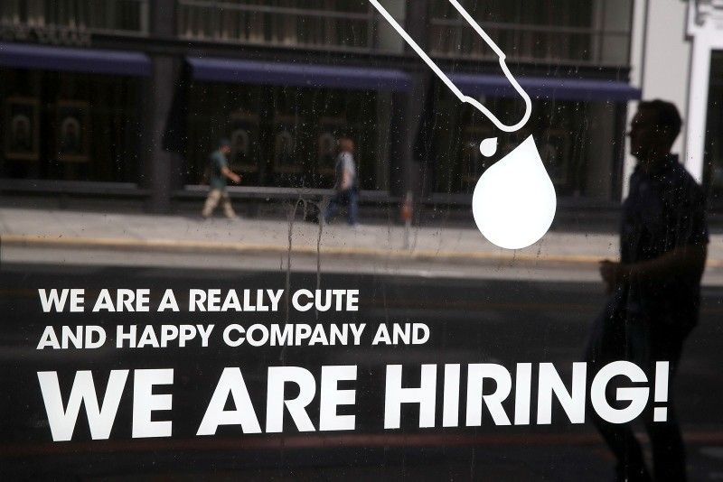 This June 1, 2018 file photo shows a 'hiring' sign posted on the window of a business on in San Francisco. (AFP Photo)