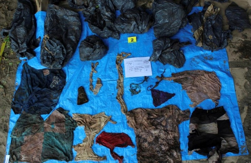 In this undated photo provided by the Veracruz State Prosecutor's Office shows clothing items found at the site of a clandestine burial pit in the Gulf coast state of Veracruz, Mexico. (AP Photo)