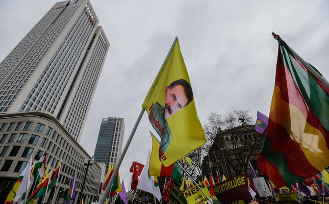 "PKK supporters carrying banners propagating for the ""no"" camp for Turkey's upcoming constitutional referendum on April 16 and a flag with a picture of the imprisoned leader of the terror group, Abdullah Öcalan, Frankfurt, Germany."