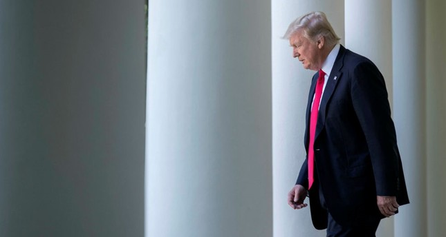 U.S. President Donald Trump walks from the Oval Office to announce the country's withdrawal from the Paris climate accord at the White House in Washington, DC, June 1.