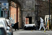 Northern Ireland police arrest four men over car bomb attack