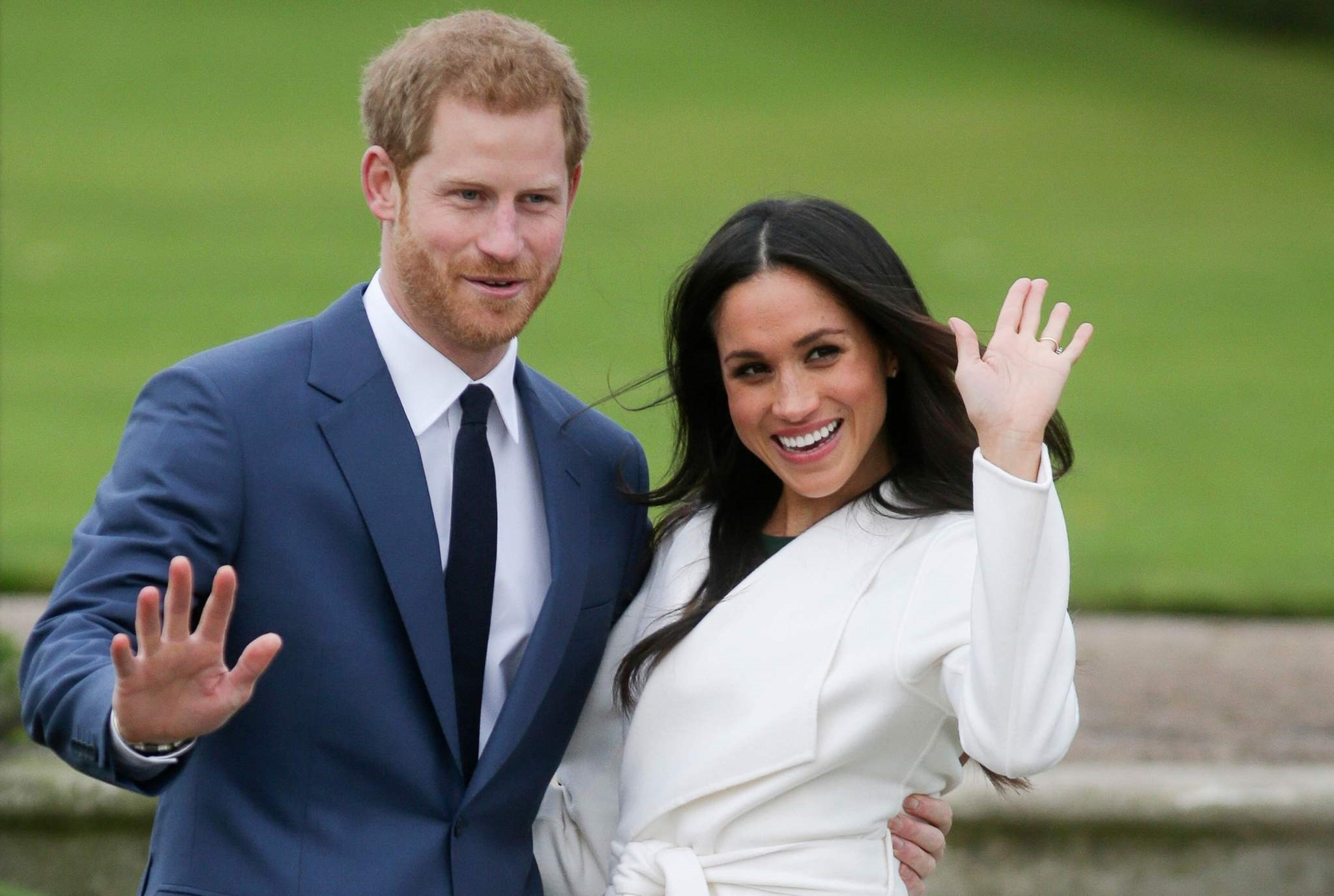This file photo taken on November 27, 2017 shows Britain's Prince Harry and his fiancu00e9e US actress Meghan Markle posing for a photograph in the Sunken Garden at Kensington Palace. (AFP Photo)