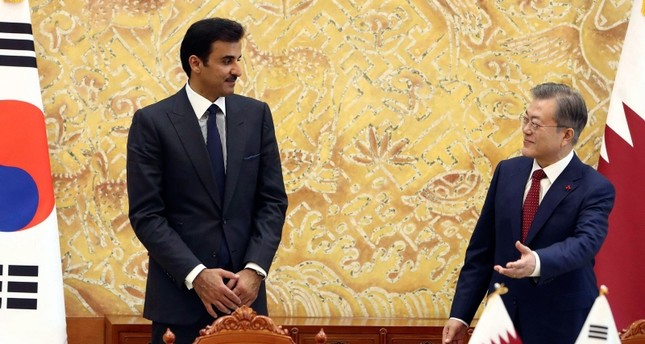South Korean President Moon Jae-in, right, and Qatar's Emir Sheikh Tamim bin Hamad Al Thani attend a signing agreement following their meeting at the presidential Blue House in Seoul, Seoul Monday, Jan. 28, 2019. (Pool Photo via AP)