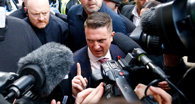 ar right activist Stephen Yaxley-Lennon, who goes by the name Tommy Robinson, leaves the Old Bailey (Reuters Photo)