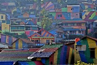 A slum area on Indonesia's Java Island has become an unlikely tourist attraction, as well as a social media hit, after its homes were painted vivid colours to transform the district into what is...