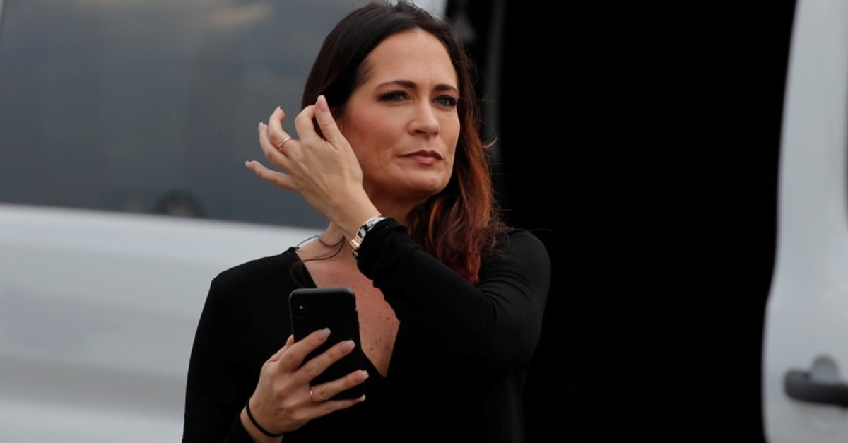 Stephanie Grisham, spokesperson for first lady Melania Trump, waits by a van after her arrival for a U.S. President Donald Trump campaign rally in Orlando, Florida, U.S., June 18, 2019. (Reuters Photo)