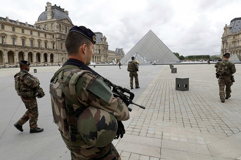 French army soldiers patrol near the Louvre Museum Pyramid's main entrance in Paris, France, June 13, 2016. (Reuters Photo)