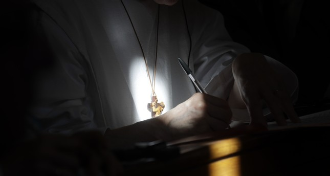 A nun takes notes as she attends a conference on the Latin Mass at Pontifical University of St. Thomas Aquinas in Rome, Sept. 14, 2017. AP Photo