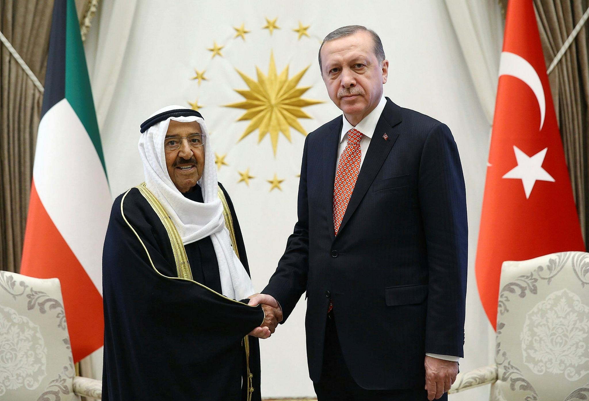 Kuwait's Emir Sheikh Sabah Al Ahmed Al Sabah, left, and President Recep Tayyip Erdou011fan shake hands before a meeting in Ankara, Turkey, Tuesday, March 21, 2017.The Emir is in Turkey for a three-day official visit.