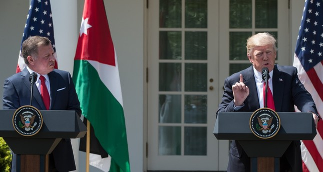 King Abdullah II of Jordan give a press conference with US President Donald Trump in the Rose Garden at the White House in Washington, DC, on April 5, 2017 (AFP Photo)