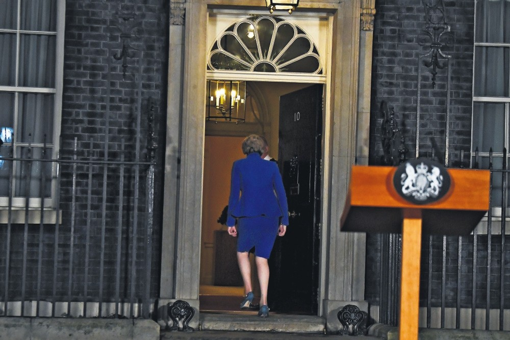 Britain's Prime Minister Theresa May leaves after making a statement following winning a confidence vote, after Parliament rejected her Brexit deal, outside 10 Downing Street in London, Britain, Jan. 16.