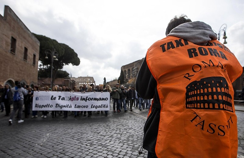 Taxi drivers march during a protest in downtown Rome, Thursday, March 23, 2017. (AP Photo)