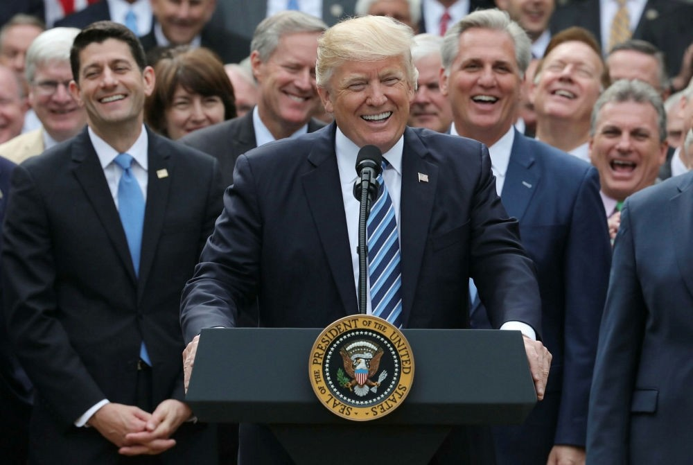 U.S. President Donald Trump celebrates with Congressional Republicans in the Rose Garden of the White House after the House of Representatives approved the American Healthcare Act Washington, D.C., May 4.