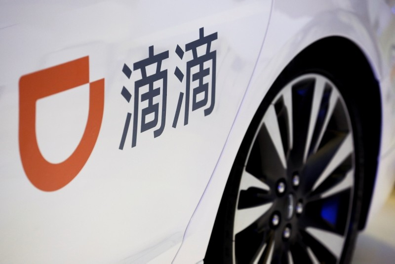 The company logo of the Didi Chuxing ride hailing app is seen on a car door at the IEEV New Energy Vehicles Exhibition in Beijing, China October 18, 2018. (REUTERS Photo)