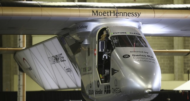 Solar plane pilots promote clean energy in New York