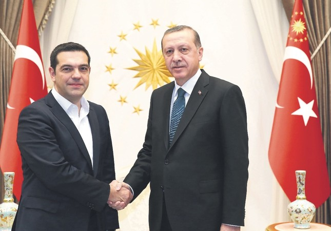 Tsipras (L) and Erdoğan will likely discuss bilateral relations, the refugee crisis and security and regional issues, particularly Syria and Iraq, during the historic visit.