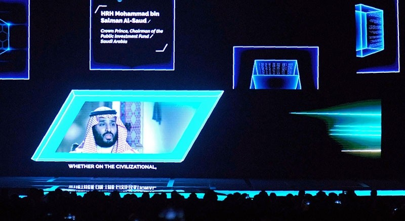 A general view shows a portrait of Saudi Crown Prince Mohammed bin Salman as people attend the Future Investment Initiative (FII) conference in Riyadh, on Oct.24, 2017. (AFP Photo)