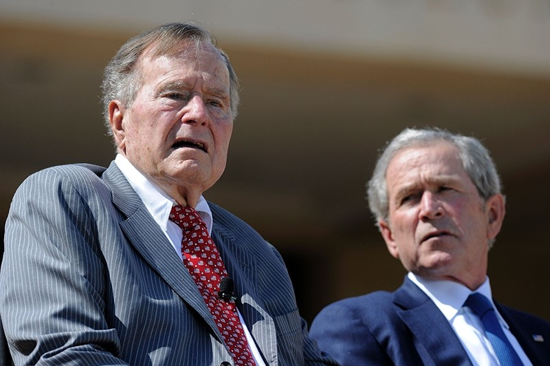 Former U.S. Presidents George Bush and his son, George W. Bush, attend the George W. Bush Presidential Center dedication ceremony in Dallas on April 25, 2013. (AFP Photo)
