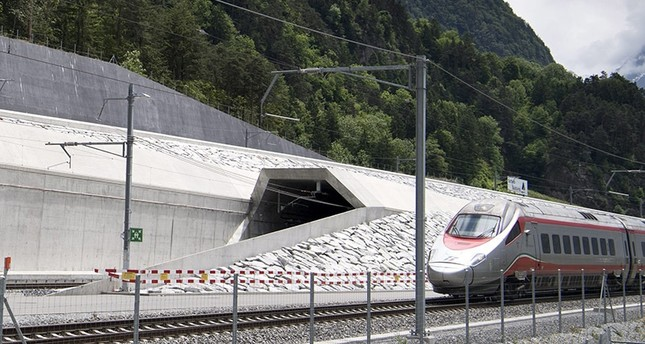 A train passes in front of the northern entrance of the Gotthard Base Tunnel on the eve of its inauguration, in Erstfeld, Canton of Uri, Switzerland, 31 May 2016 (EPA Photo)