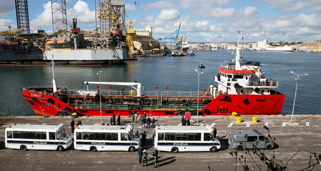 Police buses await migrants who arrived on merchant ship El Hiblu 1, in Senglea, in Valletta's Grand Harbour, Malta, March 28, 2019. (Reuters Photo)
