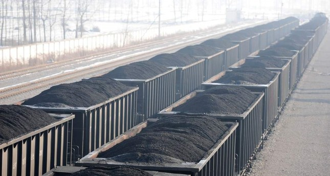 Carriages loaded with coal are seen at a mine pit of Huaibei Mining Group. China Daily via Reuters