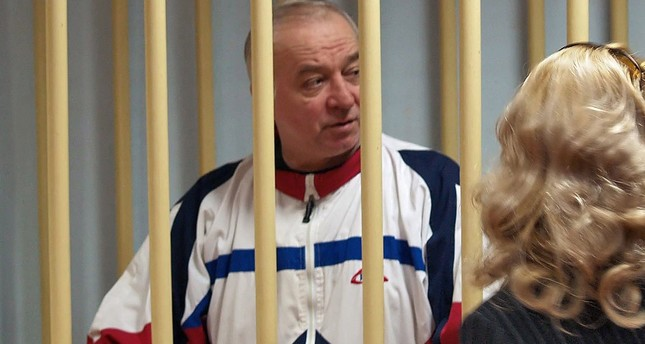 A photo dated August 9, 2006 shows Sergei Skripal talking from a defendants cage to his lawyer during a hearing at the Moscow District Military Court in Moscow. (EPA Photo)