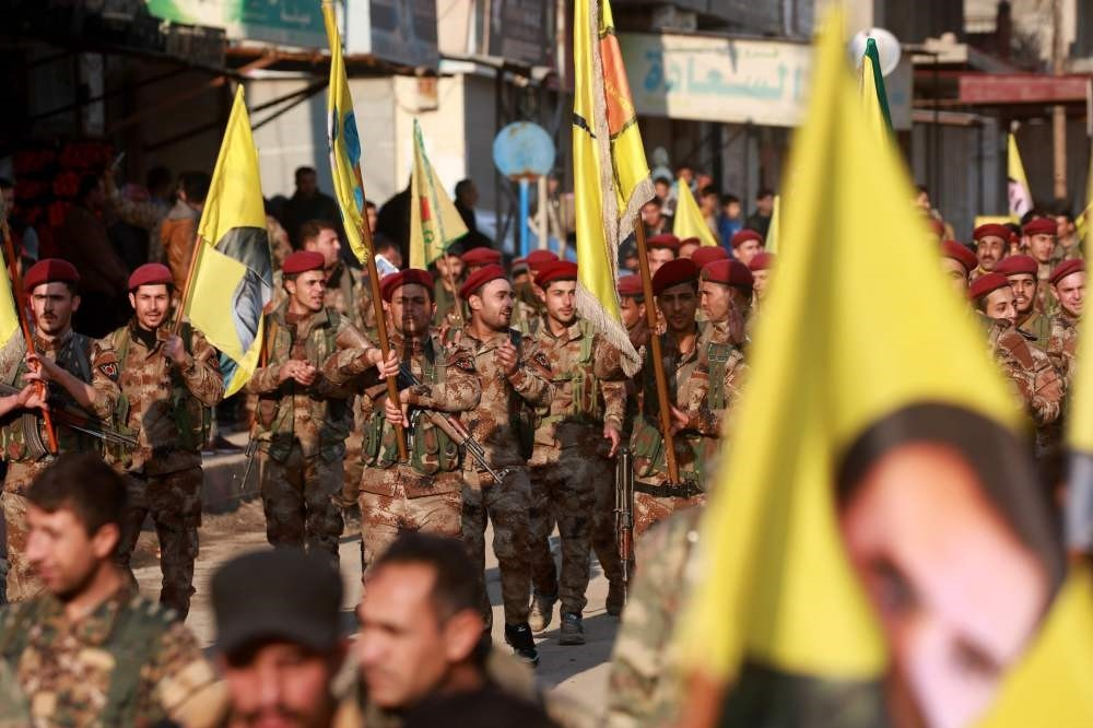 YPG terrorits demonstrate with flags and others bearing the portrait of PKK leader Abdullah u00d6calan in the town of al-Muabbadah, Hassakah, Feb. 24.