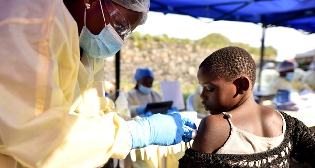 A Congolese health worker administers ebola vaccine to a child at the Himbi Health Centre in Goma, Democratic Republic of Congo, July 17, 2019. (REUTERS Photo)