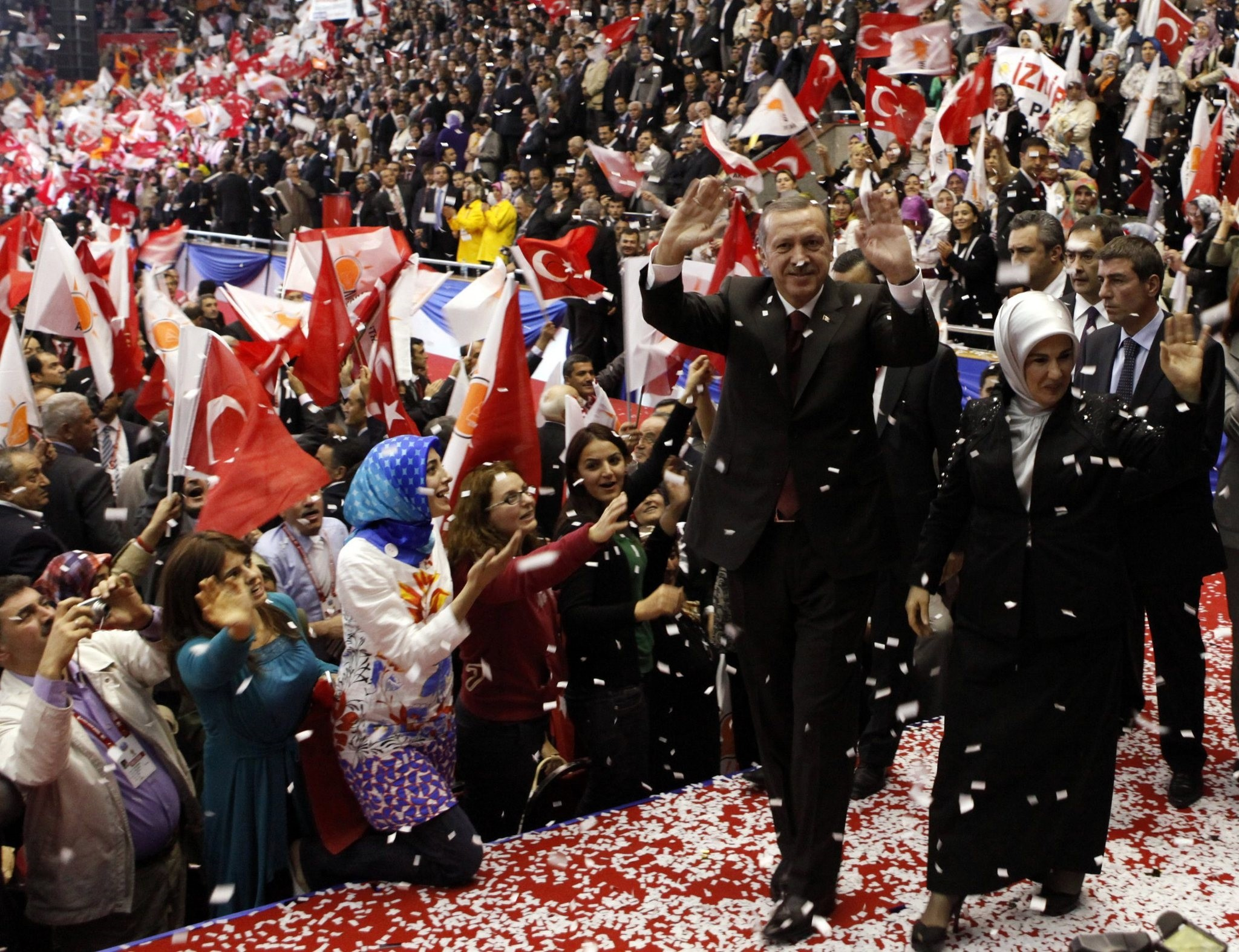 Then Prime Minister Erdou011fan, accompanied by his wife Emine Erdou011fan, greets supporters as he enters the hall for the third, AK Party congress, Ankara, Oct. 3, 2009.