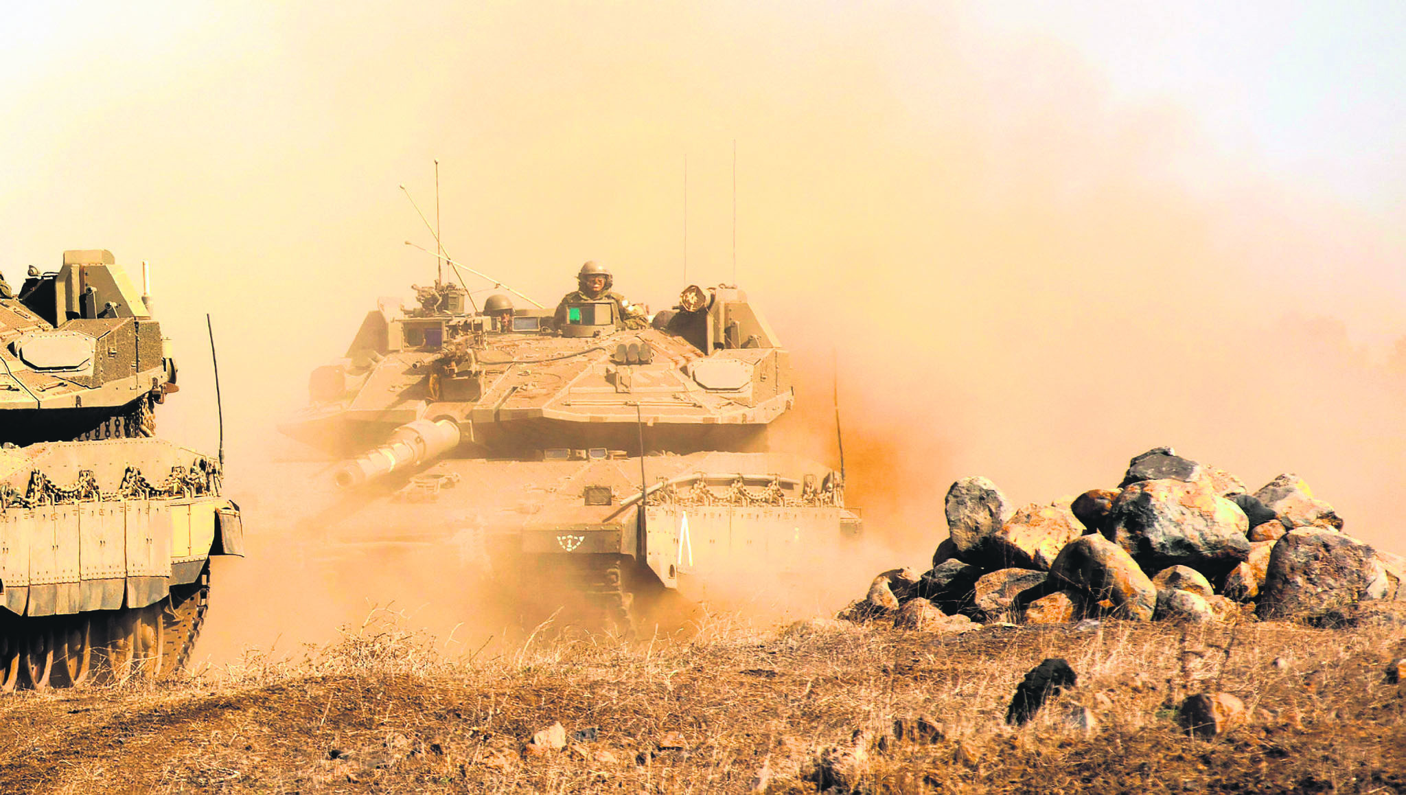 Israeli Merkava tanks take part in the second day of a large military training exercise in the Golan Heights, near the Israeli-Syrian border, Nov. 20.