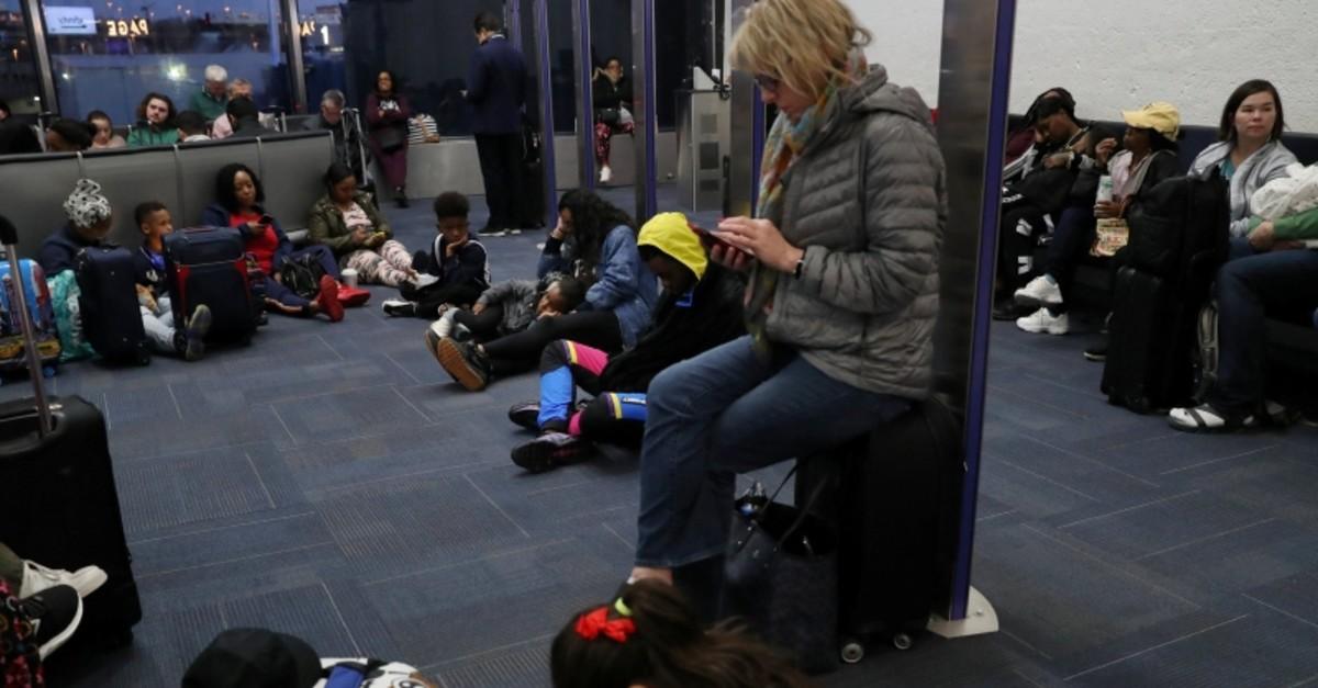 Passengers wait to board a delayed Southwest flight at Ronald Reagan Washington National Airport in Arlington, VA, U.S. April 1, 2019. (Reuters Photo)