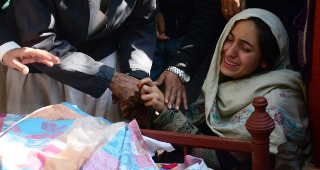 A woman mourns the death of her relative, who, according to the family, was killed in shelling, during a funeral in Nauseri village, near line of control in Pakistan-administered Kashmir, Oct. 20, 2019. (Reuters Photo)