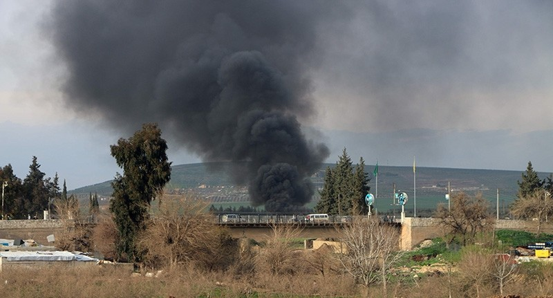 This photo shows smoke billowing from a tire fire, used by PKK-linked YPG terrorists to decrease ground visibility to Turkish jets circulating overhead, in the northern town of Afrin (AFP Photo)