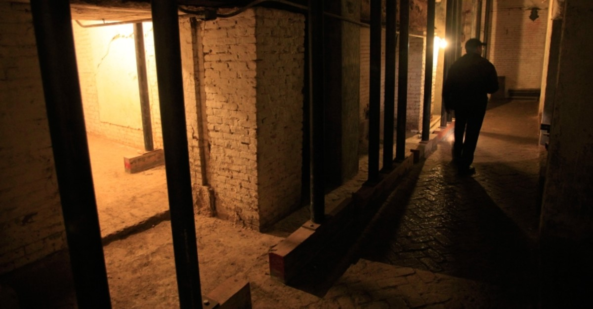 In this July 7, 2011, file photo, Jim Breeden of the Golden Gate National Parks Conservancy, walks through the dungeons below the main cell house during a night tour on Alcatraz Island in San Francisco (AP Photo)