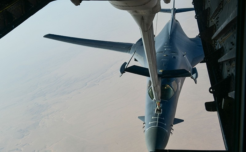 In this image obtained from the US Department of Defence, a US Air Force B-1 Bomber separates from the boom pod after receiving fuel from an Air Force KC-135 Stratotanker en route to strike chemical weapons targets in Syria (AFP Photo)