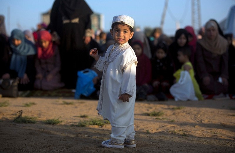 Palestinian boy in a traditional uniform stands in Eastern Gaza