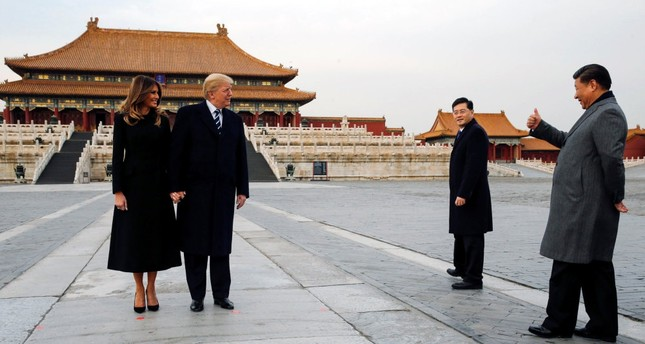 U.S. President Donald Trump and his wife first lady Melania Trump (L) visit China's Forbidden City with Chinese President Xi Jinping (R), Beijing, November 2017.