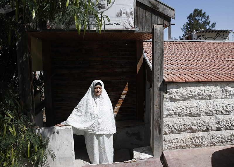 Palestinian Fahamiya Shamasneh stands outside her family house in the occupied east Jerusalem neighbourhood of Sheikh Jarrah on August 1, 2017, despite a looming deadline for evacuating the home she has lived in for more than 50 years. (AFP Photo)