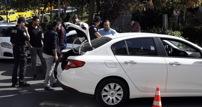 The police search a car near the Iranian embassy in Ankara, Turkey after unconfirmed reports of a suicide bomb threat to the diplomatic mission.