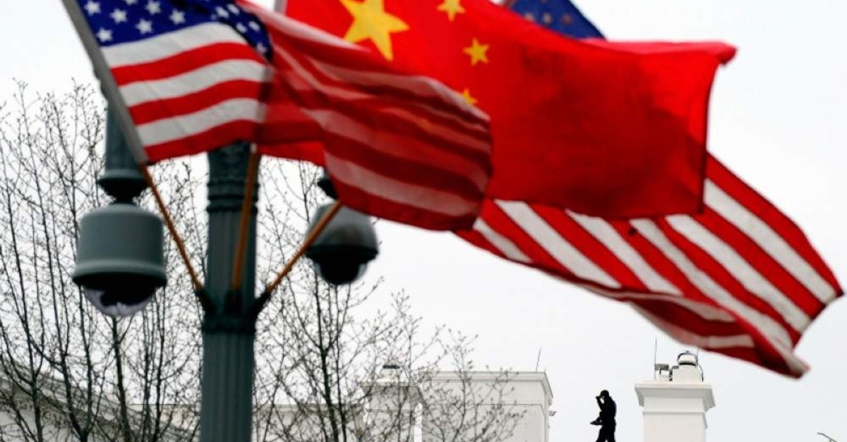 In this file photo taken on Jan. 17, 2011, a Secret Service agent guards his post on the roof of the White House as a lamp post is adorned with Chinese and U.S. national flags in Washington, DC. (AFP Photo)