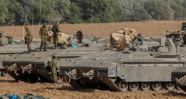 Israeli soldiers stand on armored vehicles near the border with the Gaza Strip, Nov. 13, 2019. (AFP Photo)