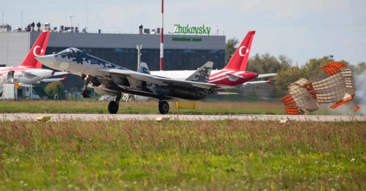 Russian Air Force Sukhoi Su-57 fighter jet lands after performing as Turkish president's delegation planes are parked in the background during the MAKS-2019 International Aviation and Space Show in Zhukovsky, Russia, Aug. 27, 2019. (AP Photo)