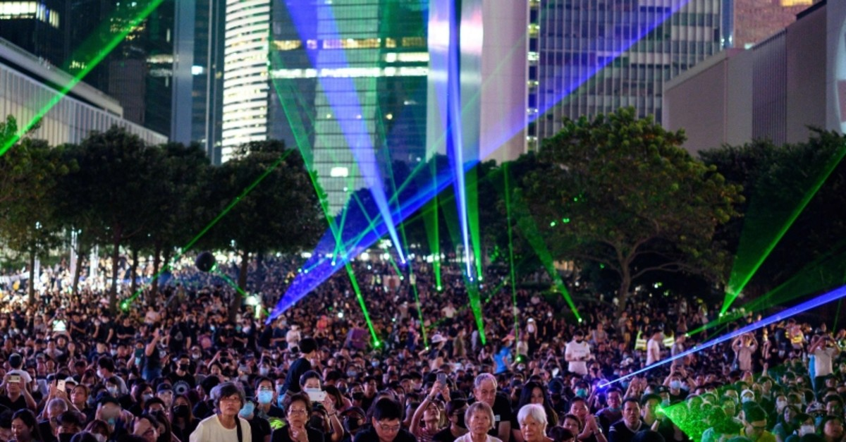 People attend a rally to mark the fifth anniversary of the ,Umbrella Movement,, in the Admiralty area of Hong Kong on September 28, 2019. (AFP Photo)
