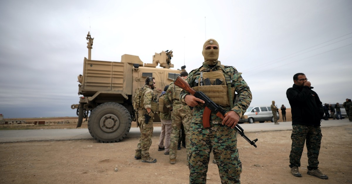 PKKu2019s Syrian affiliate Peopleu2019s Protection Units (YPG) and U.S. troops patrolling near Turkish border in Hasakah, Syria, Nov. 4, 2018.