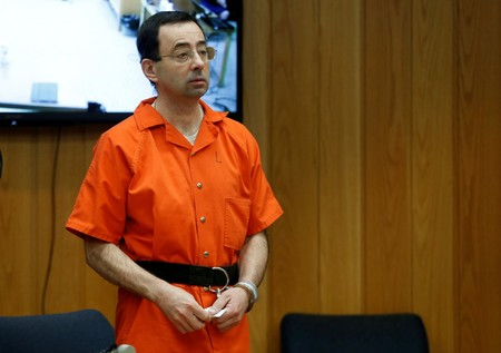 Larry Nassar, a former team USA Gymnastics doctor who pleaded guilty in Nov. 2017 to sexual assault charges, stands in court during his sentencing hearing in the Eaton County Court in Charlotte, February 5, 2018.