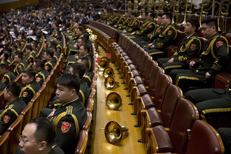 A military band rest during the opening session of the Chinese People's Political Consultative Conference (CPPCC) which was held in Beijing, China, Friday, March 3, 2017. (AP Photo)