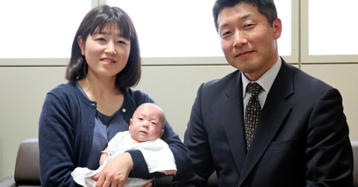 Ryusuke Sekino, a 5-month-old boy who was just 258 grams (9 ounces) when born, sits in the arms of his mother Toshiko Sekino, accompanied by his father Kohei Sekino, right, at a hospital in Azumino, Nagano Prefecture, central Japan (AP Photo)