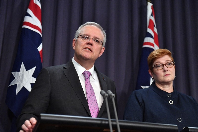 Prime Minister Scott Morrison, left, speaks to the media alongside Minister for Foreign Affairs Marise Payne during a press conference at the Parliament House in Canberra, Tuesday, October 16, 2018.  (AP Photo)