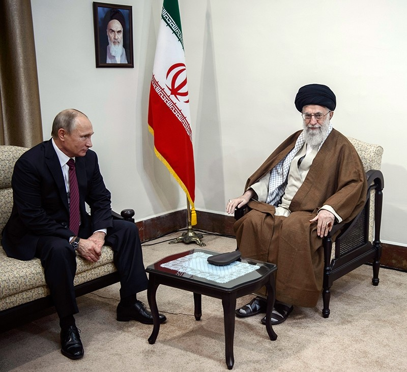 Supreme Leader Ayatollah Ali Khamenei, right, speaks with Russian President Vladimir Putin during their meeting in Tehran, Iran, Nov. 1, 2017. (AP Photo)